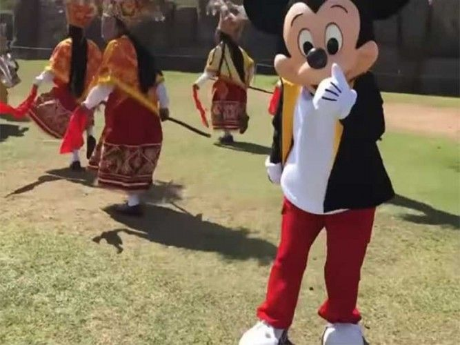 Mickey Mouse joining locals for a traditional dance at the Sacsayhuaman ruins in Cusco, Peru; photo: FB video