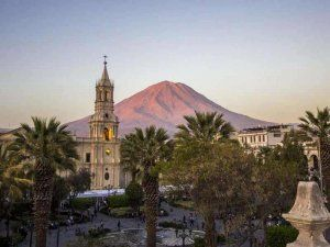 Arequipa's main square with the imposing cathedral and the Misti volcano in the back, photo: Black Tomato